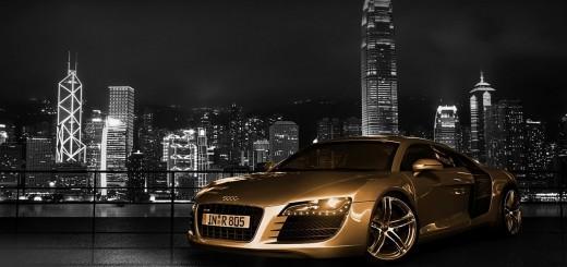 wallaper hd Audi A8 con un fondo de ciudad nocturna
